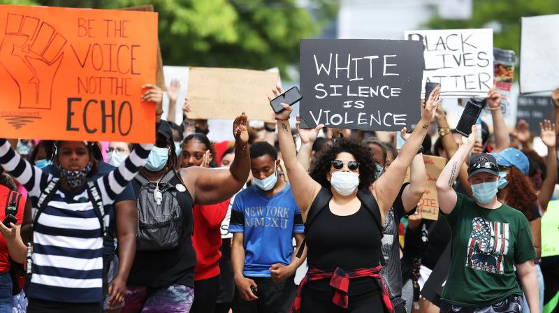 Protesters march on June 07, 2020 in Freeport, New York. (AFP)