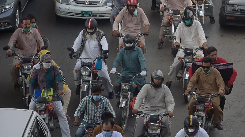 Commuters return from the capital city of Islamabad, in Rawalpindi. (AFP)