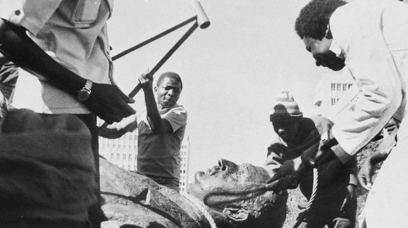 In this July 31, 1980, file photo, Rhodesians beat a statue as they celebrate the removal of Rhodesia's founder, Cecil Rhodes, after Rhodesia, became independent in April, ending nine decades of British colonial rule and becoming Zimbabwe. (AP)