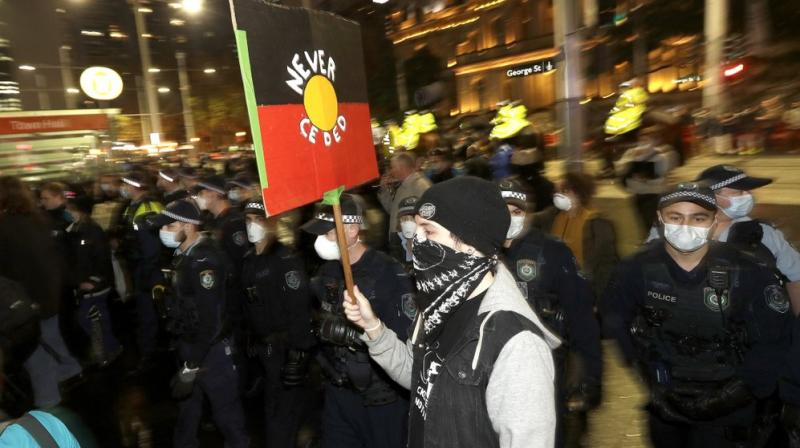 Police move in to disperse protesters that had gathered in Sydney, Friday, June 12, 2020, to support U.S. protests over the death of George Floyd. Hundreds of police disrupted plans for a Black Lives Matter rally but protest organizers have vowed that other rallies will continue around Australia over the weekend despite warnings of the pandemic risk. (AP)