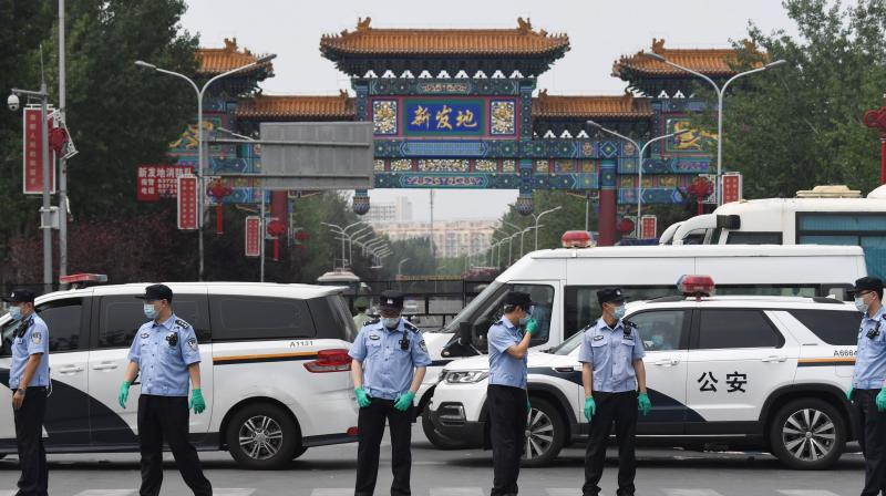 Chinese police guard the entrance to the closed Xinfadi market in Beijing. (AFP)