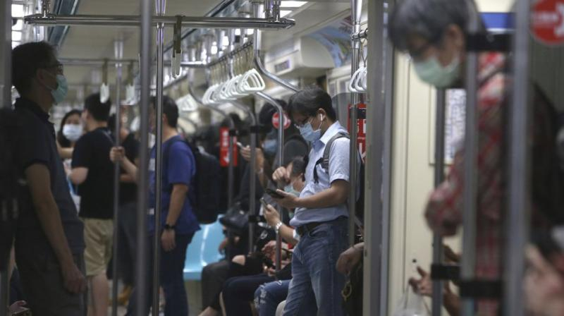 People wear face masks to protect against the spread of the coronavirus as they ride the subway in Taipei, Taiwan. (AP)