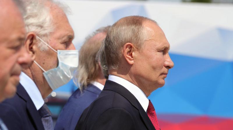 Russian President Vladimir Putin (right). (AP)