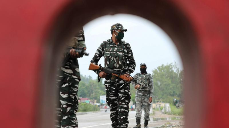 CRPF personnel patrol Jammu-Srinagar national highway at Nagrota outskirts, in Jammu. (PTI)
