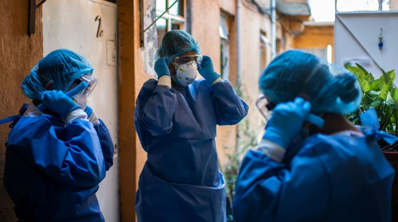 A health brigade gets ready while on door-to-door visits to carry out COVID-19 tests in Mexico City. (AFP)