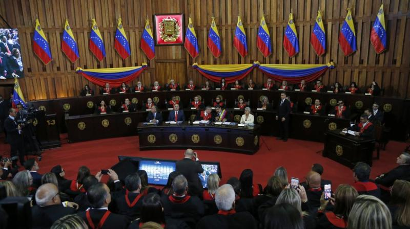 Venezuelan President Nicolas Maduro, sitting at desk second from right, speaks with Supreme Court President Maikel Moreno at the Supreme Court before giving his annual presidential address in Caracas, Venezuela. (AP)