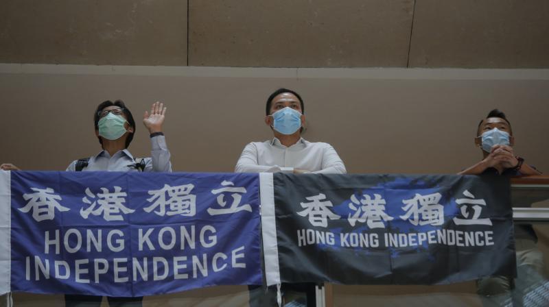 Pro-Hong Kong demonstrators display flags during a protest at a shopping mall in Hong Kong. (AP)
