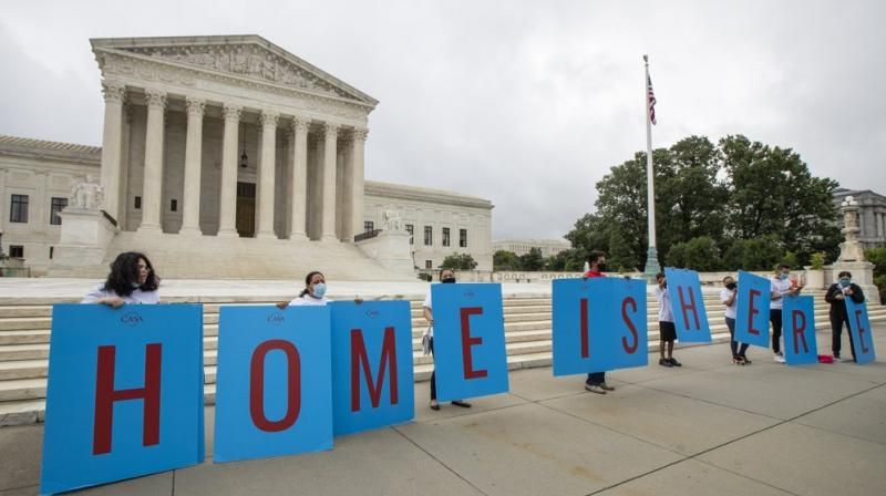 Deferred Action for Childhood Arrivals (DACA) students gather in front of the Supreme Court on Thursday, June 18, 2020, in Washington. (AP)