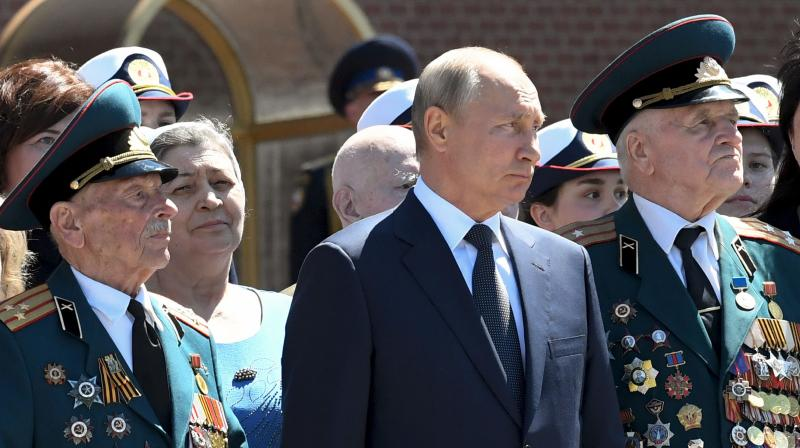 Russian President Vladimir Putin (center). (AP)