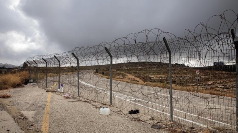 A section of Israel's separation barrier blocks a road near the West Bank Jewish settlement of Beit Horon. (AP)