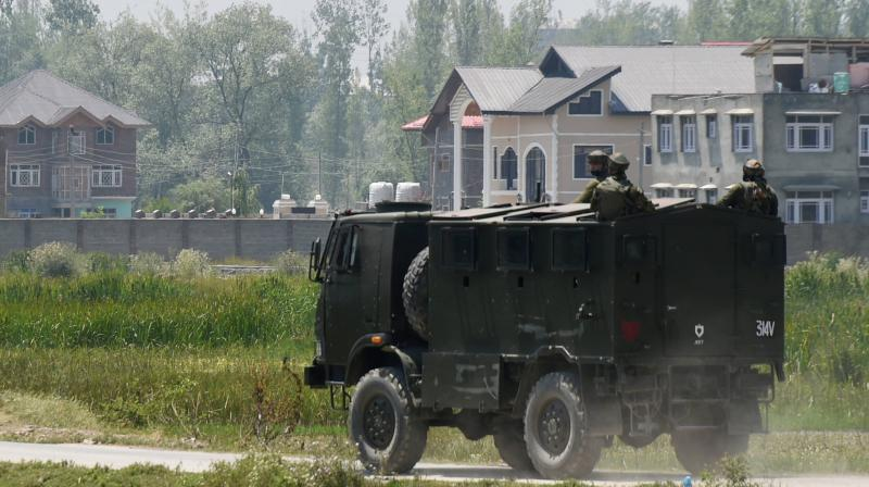 An Army vehicle arrives at the spot of encounter with militants at Pampore in Pulwama District of South Kashmir. (PTI)