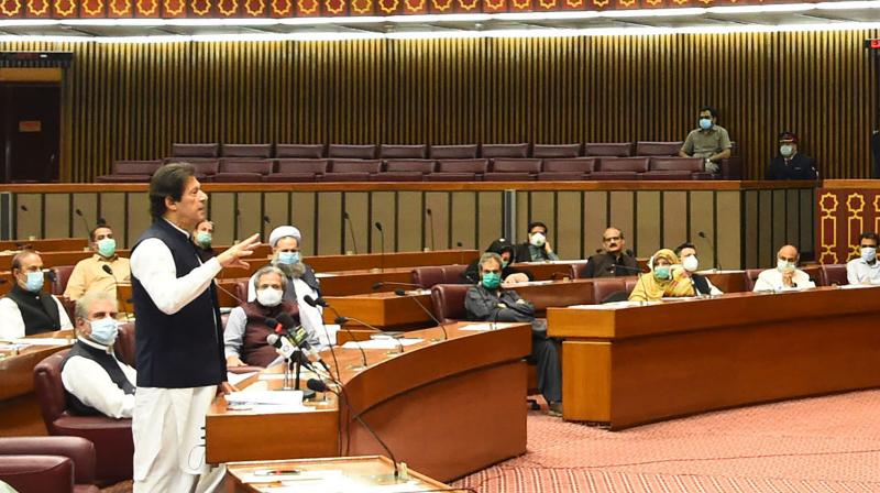 Pakistani Prime Minister addresses the Parliament in Islamabad, Pakistan. (Photo released by the Press Information Department)