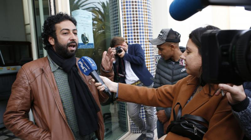 Journalist and activist Omar Radi speaks to the media after his hearing at the Casablanca Courthouse, In Casablanca, Morocco.(AP)