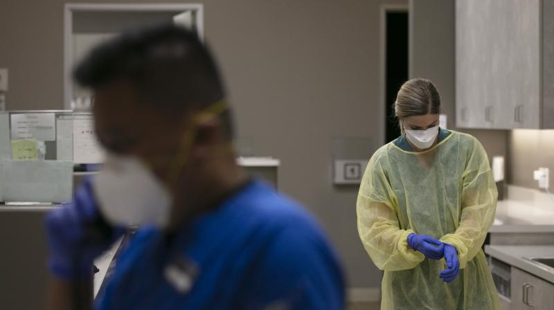 Physician assistant gets ready for COVID-19 testing at Xpress Urgent Care in Tustin, California. (AP)