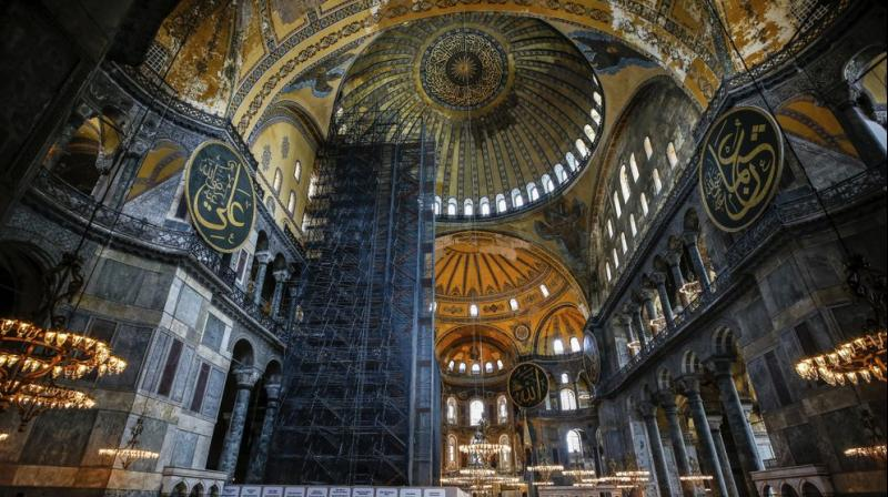 People visit the Byzantine-era Hagia Sophia, one of Istanbul's main tourist attractions in the historic Sultanahmet district of Istanbul. (AP)