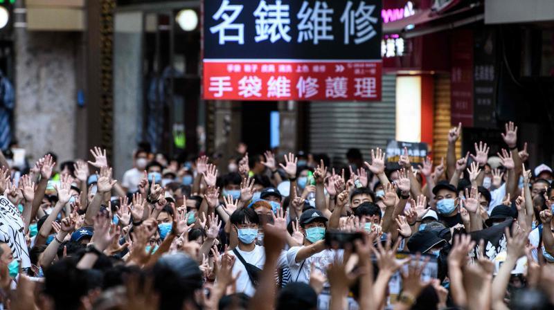 Protesters chant slogans and gesture during a rally against a new national security law in Hong Kong on July 1, 2020, on the 23rd anniversary of the city's handover from Britain to China. (AFP)