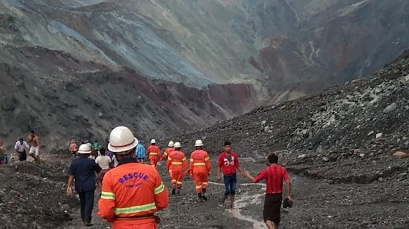 This handout from the Myanmar Fire Services Department taken and released on July 2, 2020 shows rescuers attempting to locate survivors after a landslide at a jade mine in Hpakant, Kachin state. (AFP)
