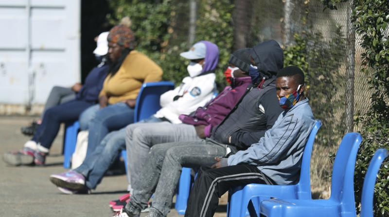 Vaccine volunteers are seated, at the Chris Hani Baragwanath hospital in Soweto, Johannesburg Wednesday, June 24, 2020. (AP)