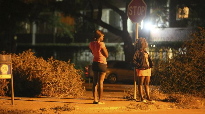 Sex workers wait for clients in the red light district of Harare, Zimbabwe. (AP)