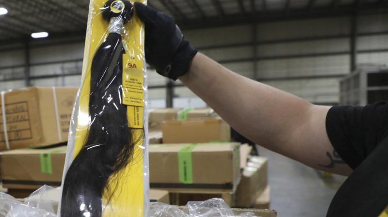 US Customs and Border Protection detained a shipment of weaves believed to be made in a Chinese detention camp. The shipment is suspected to be human hair. (U.S. Customs and Border Protection via AP)