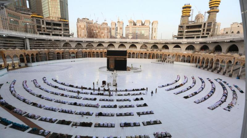Worshippers gathering before the Kaaba at the Grand Mosque in Saudi Arabia's holy city of Mecca to attend prayers. (AFP)