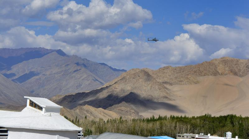 An IAF helicopter flies in the sky, in Leh, Ladakh. (PTI)