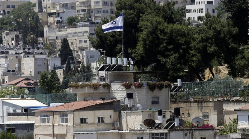 An Israeli flag flies over a Jewish owned house in a Palestinian neighborhood of Silwan in east Jerusalem. (AP)