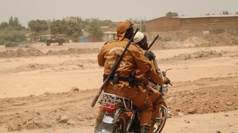 Local defense force fighters drive on a motorbike during an event to inaugurate a new chapter of the group in Ouagadougou, Burkina Faso. (AP)