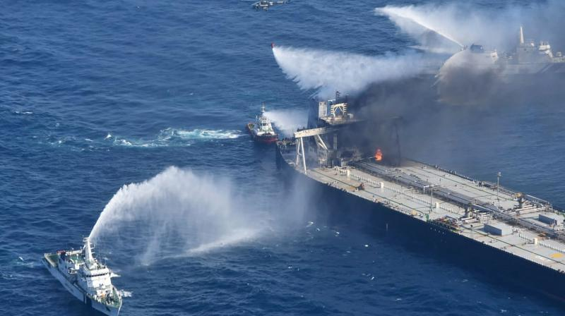 Tug boats and ships battle the fire on MT New Diamond, off the eastern coast of Sri Lanka in the Indian Ocean, Saturday, Sept. 5, 2020. The fire on the large oil tanker off Sri Lanka's coast has been brought under control but is still not extinguished, the navy said Saturday. The tanker, carrying nearly 2 million barrels of crude oil, was drifting about 20 nautical miles (37 kilometers) from Sri Lanka's eastern coast and on Friday evening a tug boat towed it to the deep sea away from land, said navy spokesman Capt. Indika de Silva. (AP)