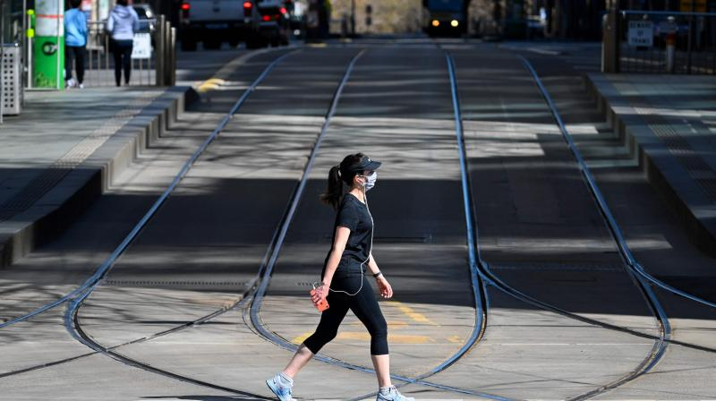 A woman takes a walk in Melbourne on September 6, 2020 as the state announced an extension to its strict lockdown law while it battles fresh outbreaks of the COVID-19 coronavirus. (AFP)