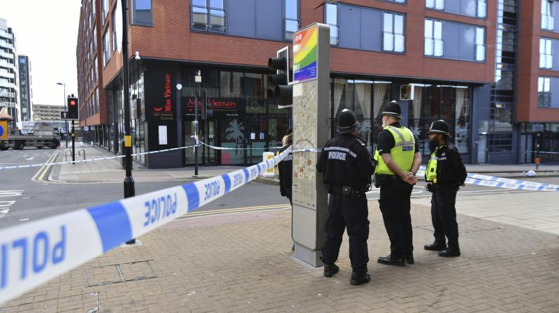 Police officers stand at a cordon in Hurst Street in Birmingham after a number of people were stabbed in the city centre, Sunday, Sept. 6, 2020. British police say that multiple people have been injured in a series of stabbings in a busy nightlife area of the central England city of Birmingham.(AP)