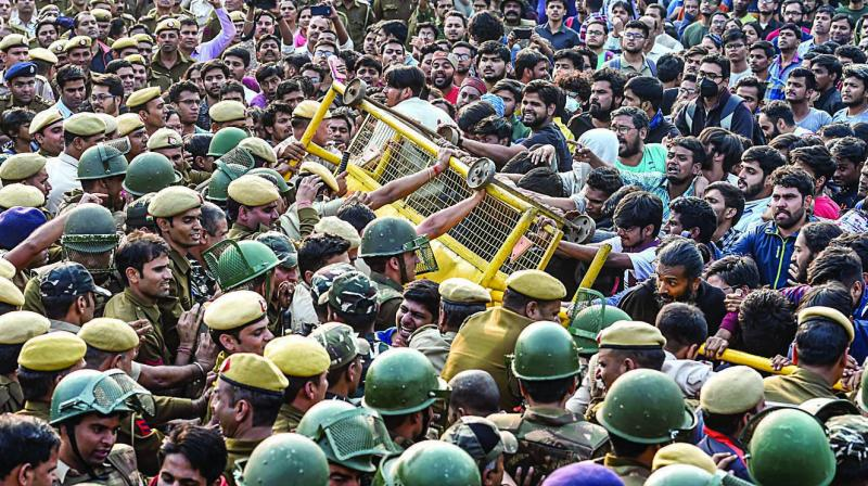 Cops stop Jawaharlal Nehru University students during a protest over the hostel-fee hike and the administrations alleged anti-students policy in New Delhi on Monday. (Photo: PTI)