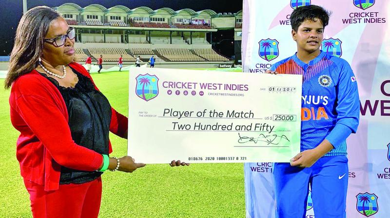 Teenager Shafali Verma (right) collects her player of the match cheque. (Photo: BCCI)