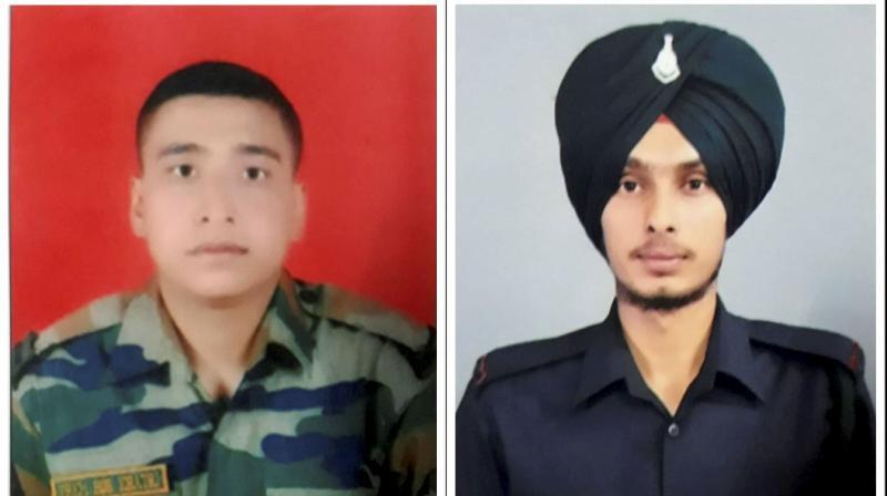 Martyr Naik Prem Bahadur Khatri (left) and martyr Rifleman Sukhbir Singh who lost their lives during the ceasefire violation by Pakistan Army, at Sunderbani Sector of Rajouri district, Friday, Nov. 27, 2020. (PTI)