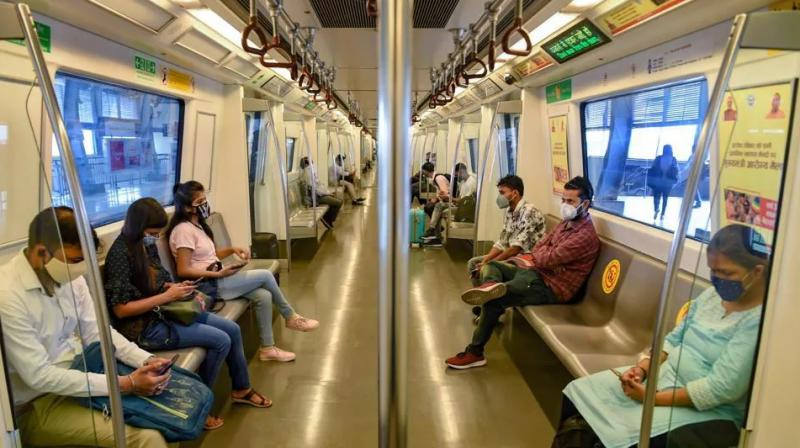 Commuters in a train after the Delhi Metro resumed services. (Photo: PTI)