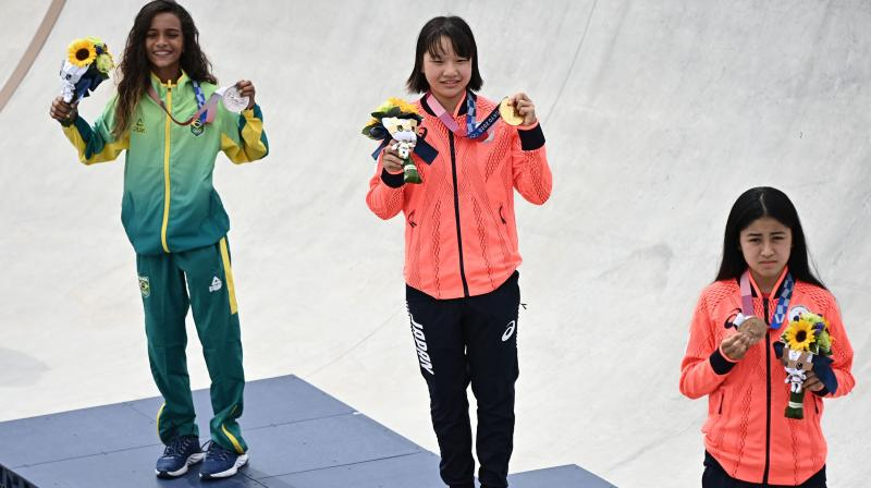 Medal winners will be allowed to take off their mask for 30 seconds on the podium. (Photo: AFP)