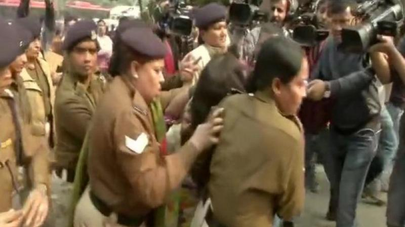 A woman protesting against Unnao rape case, allegedly threw petrol on her six-year-old daughter outside Safdarjung Hospital on Saturday. (ANI)