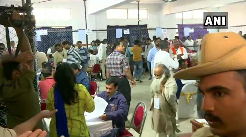 The counting of votes for the by-elections on 15 assembly seats in Karnataka that went to polls on December 5 is underway at 11 centres in the state. (Photo: Twitter/ ANI)