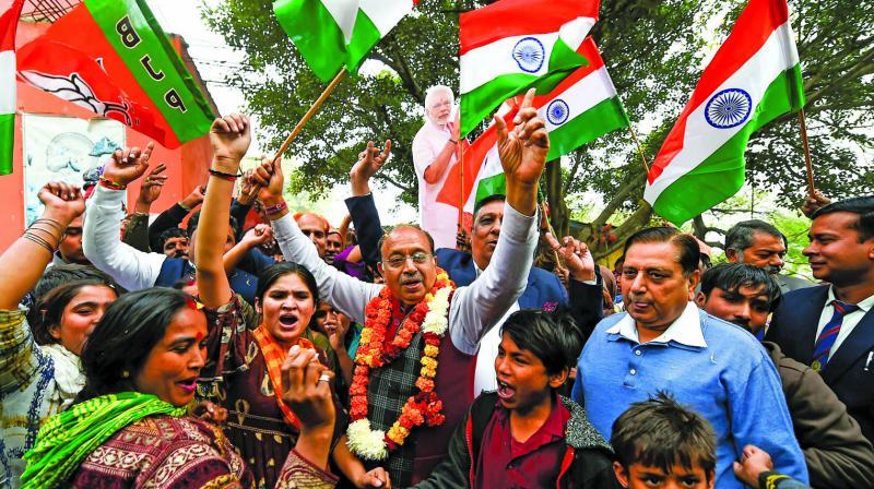 BJP MP Vijay Goel celebrates the passage of Citizenship (Amenment) Bill with Hindu refugees from Pakistan at Majnu ka Tilla in New Delhi on Thursday. (Photo: PTI)