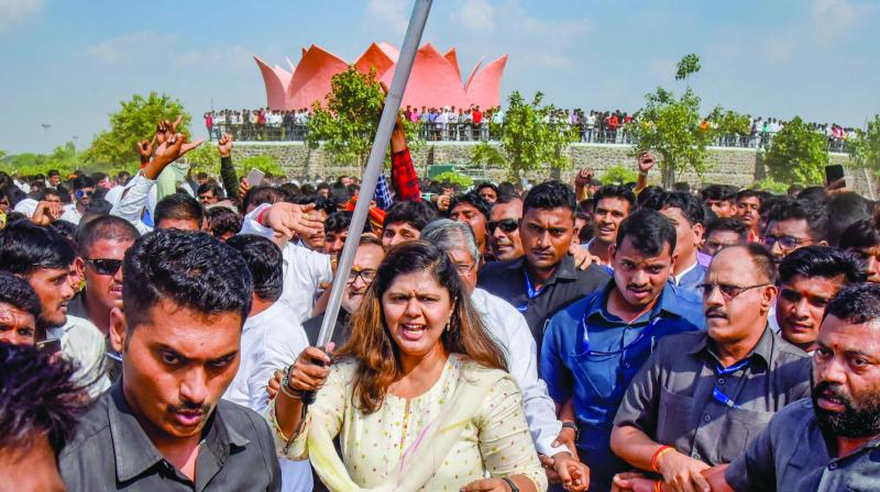 Senior BJP leader Pankaja Munde holds a police baton during her public rally on the occasion of the birth anniversary of her late father Gopinath Munde. (Photo: PTI)