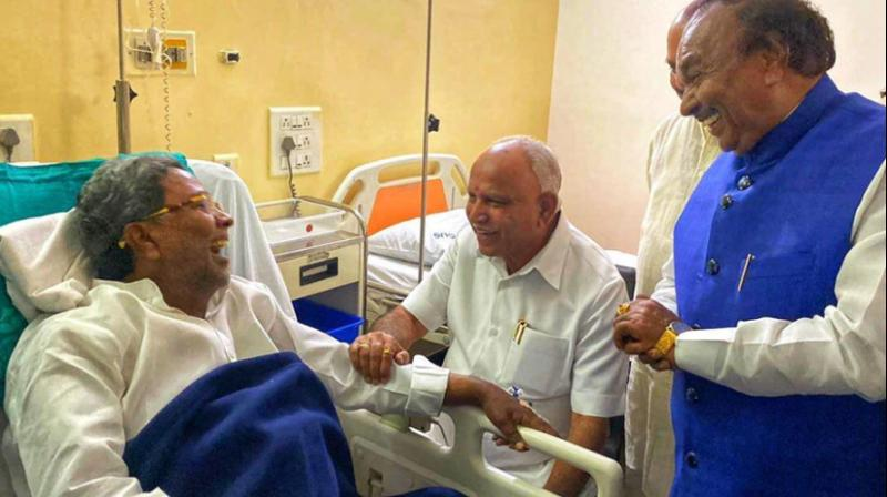 Karnataka Chief Minister BS Yediyurappa on Thursday visited Congress leader Siddaramaiah who is admitted in a hospital in Bengaluru after he complained of chest pain on Wednesday night. (Photo: Twitter/ Karnataka BJP)