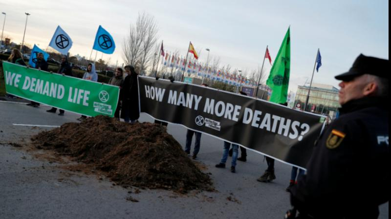 Green activists dumped horse manure and staged a mock hanging outside the venue of a UN climate summit in Madrid on Saturday, airing their frustration at the failure of world leaders to take meaningful action against global warming. (Photo: Screenshot)