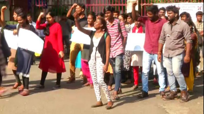 A section of the students of the Madras Universtiy continued their protest for the second day on Tuesday against the amendment to the Citizenship Act by staying put inside the Marina campus here, as police entered the premises. (Photo: ANI)