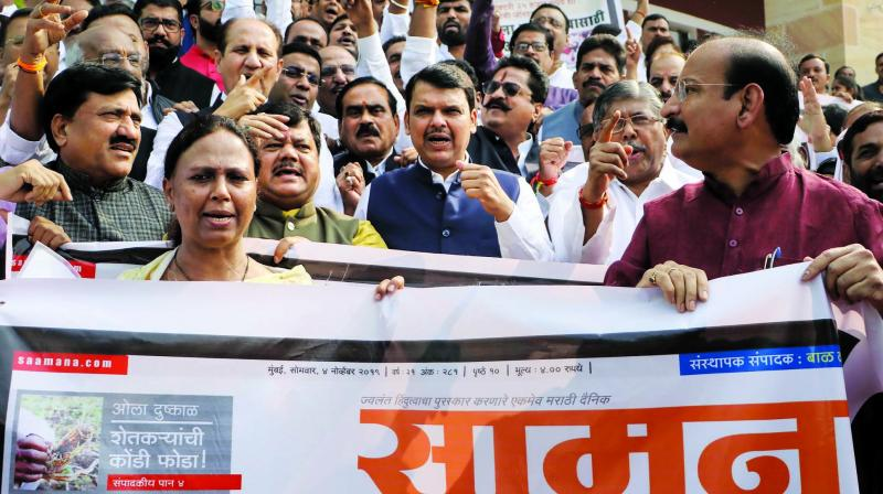 LoP Devendra Fadnavis and other BJP MLAs protest against the Shiv Sena on Tuesday. (Photo: PTI)