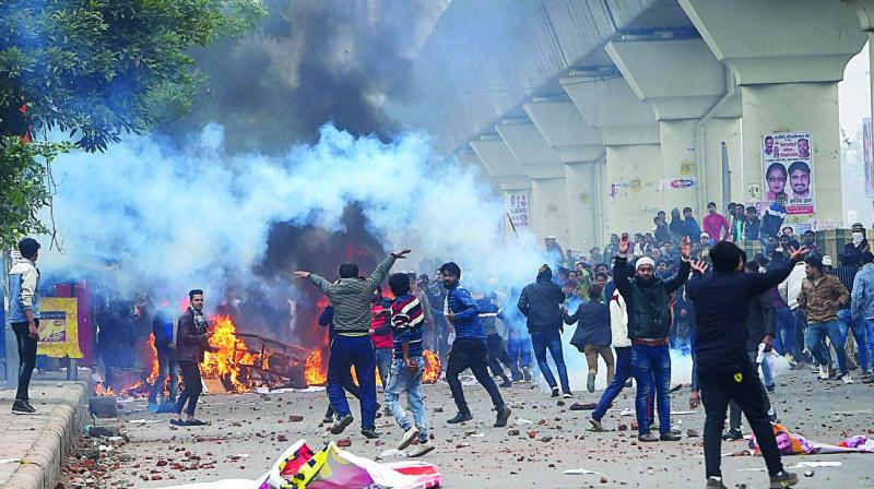 Brickbats lie on a road as protestors against Citizenship Amendment Act clash with police at Seelampur in New Delhi on Tuesday. (Photo: AP, PTI)