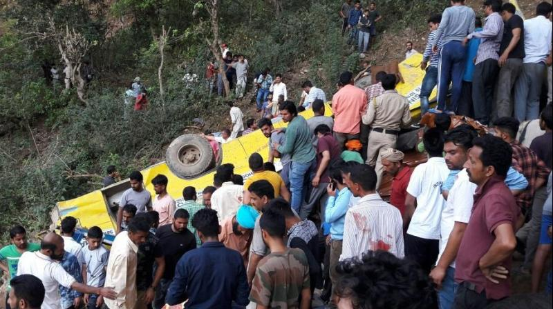 According to reports, the driver lost control on a sharp curve due to which the bus slipped into the gorge and came to rest in the middle of the hillside. (Photo: ANI/Twitter)