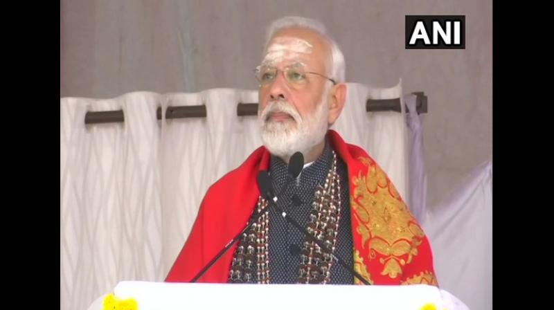 Prime Minister Narendra Modi speaks at an event at the Sree Siddaganga Mutt in Tumakuru, Karnataka on Thursday. (Photo: ANI)