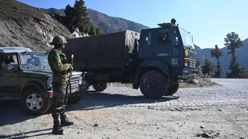 Indian Army soldiers stand guard near Nastachun pass, also known as Sadhana pass, about 8 Km from the Line of Control (LOC) in the district of Kupwara. (AFP)