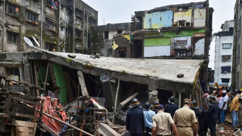 Fire brigade and police conduct search and rescue operation after a three storey building collapsed at Bhiwandi in Thane district Monday Sept. 21 2020. (PTI)