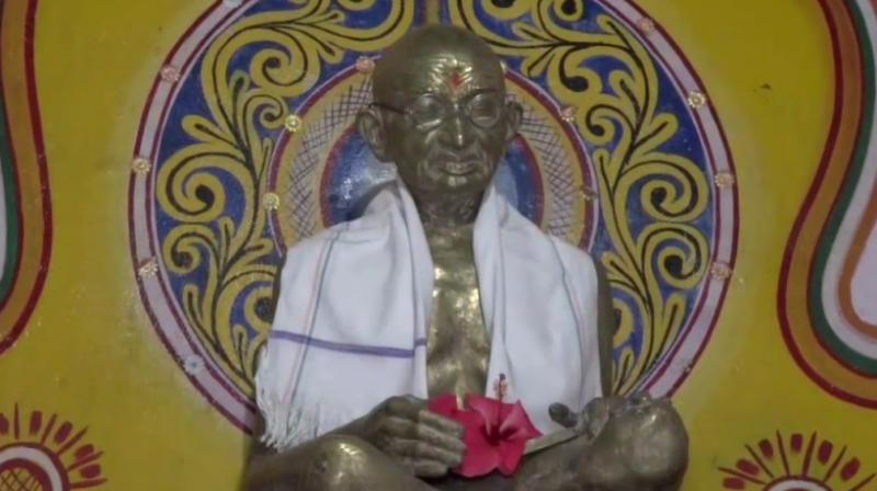 Statue of Gandhi installed in the temple.
